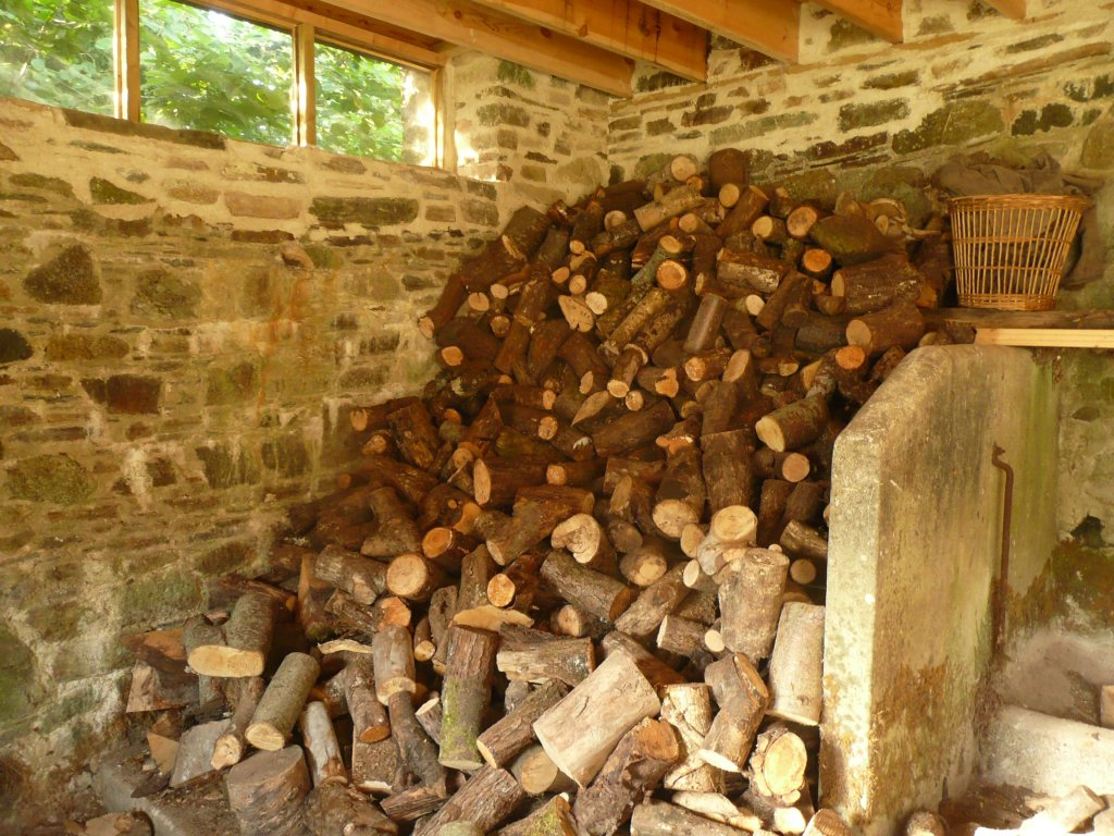 Wood pile in barn www.thinkingcowgirl.wordpress.com