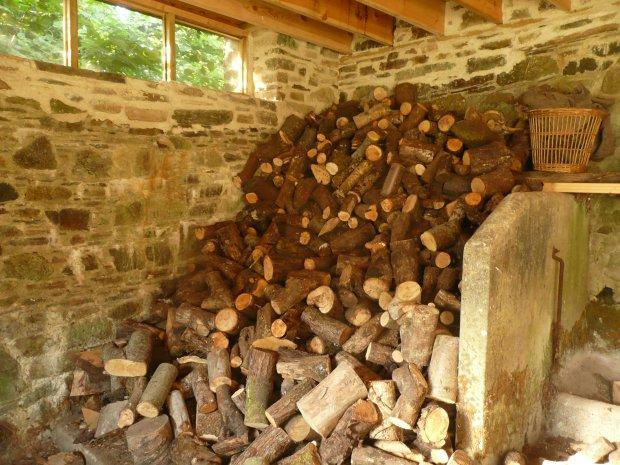 Wood pile in barn www.thinkingcowgirl.wordpress.com