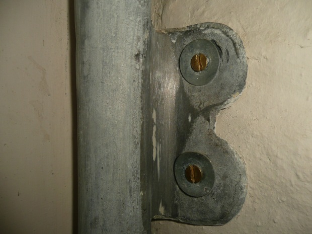 Lead Pipe fixed to Wall