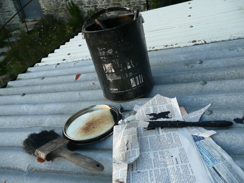 Mending Roof with Tar Paint