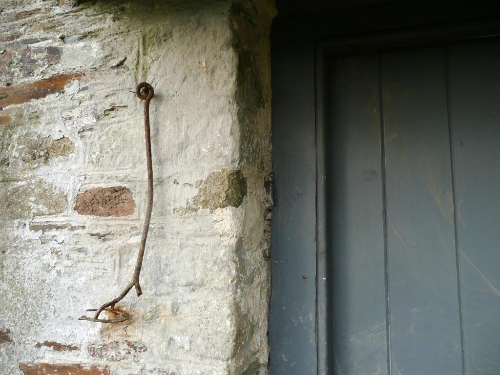 Old Branding iron by door www.thinkingcowgirl.wordpress.com